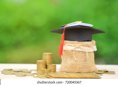 Graduation hat on the bag with Stack of gold coins money on natural green background, Saving money for education concept