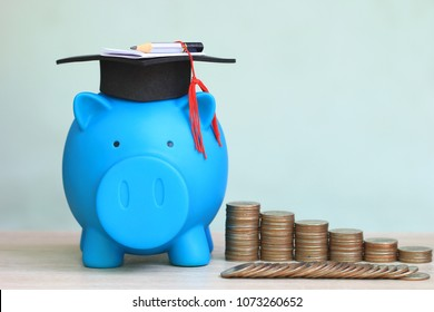 Graduation hat on piggy and stack of coins money on white background, Saving money for education concept