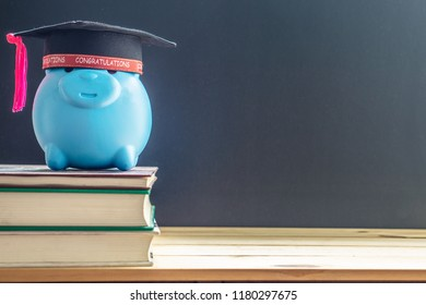 graduation hat with piggy bank on books  and blackboard background