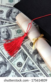 Graduation hat and scroll on money background