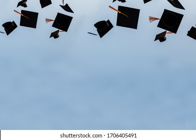 Graduation hat Thrown in the Air with bluesky abstract background.