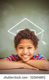 Graduation hat vector against little boy smiling in classroom