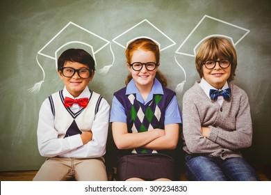 Graduation hat vector against smiling little school kids in classroom