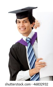 graduation man displaying a banner ad isolated over white