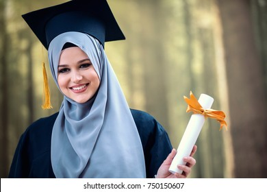 graduation, pretty girl with hijab holding diploma, concept, success