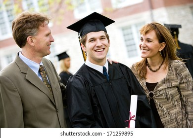 Graduation: Proud Male Student With Parents