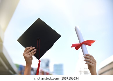 Graduation student learner is finish education school university degree and get diploma and mortarboard she raise hand up to the blue sky showing her proud using for copy space or background