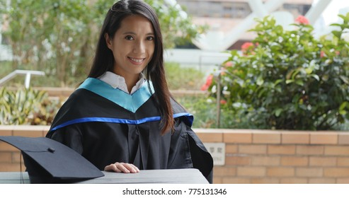 Graduation woman wearing gown in university campus
