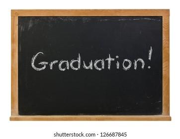 Graduation written in white chalk on a black chalkboard