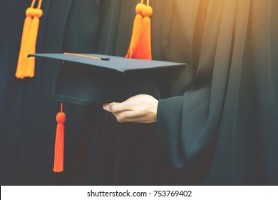 graduation,Student hold hats in hand during commencement success graduates of the university,Concept education congratulation.Graduation Ceremony,Congratulated the graduates in University.