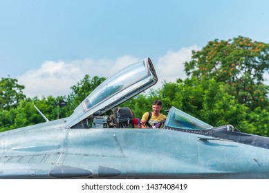GRAF IGNATIEVO, BULGARIA - JUNE 29 2019: Father and son watch Mig 29 cockpit during open day for visiting with military equipment exposition in Graf Ignatievo airport, Bulgaria