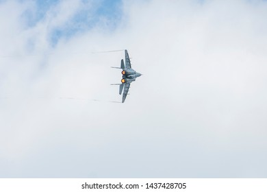 GRAF IGNATIEVO, BULGARIA - JUNE 29 2019: Mikoyan Gurevich MiG-29 multifunctional jet fighter plane on blue sky with white clouds on flying show