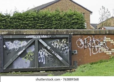 graffite written on walls and gate