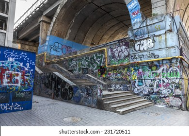 Graffiti artist illegally abandoned in a ruined building. Beautiful street art. Urban contemporary culture. In dark colors. selective Focus