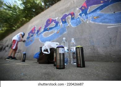 Graffiti artist painting/Sofia, Bulgaria - July 14, 2012: A graffiti artist is painting his artwork on a wall. He is participating in the annual Urban graffiti festival in Sofia.