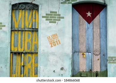 "Graffiti of Cuban Flag and slogan ""Viva Cuba Libre"" on the wall"