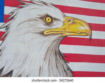 graffiti of an eagle with the american flag in the background