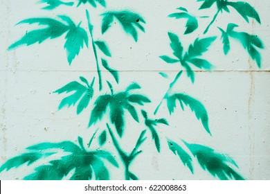 Graffiti green hemp bush on a white wall.