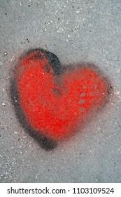 graffiti heart on concrete wall