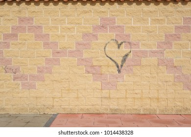 Graffiti heart on a wall.