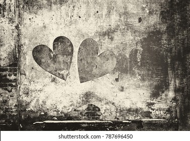 Graffiti heart on the wall in grunge style