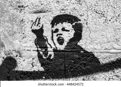 Graffiti on the wall, angry kid. fuck you