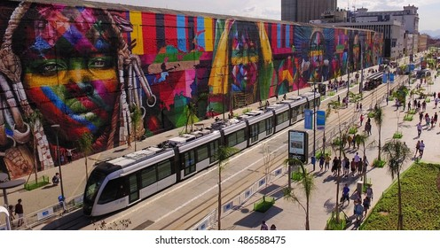 Graffiti painting at downtown Rio de Janeiro and the vlt train - praça mauá. Artist Kobra