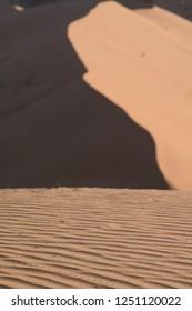 grafic lines on huge sand dune in the Sahara at beauty morning light