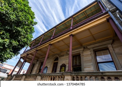 GRAFTON, AUSTRALIA – April 9, 2019: Facade of a heritage building with classical architecture elements such as Ionic columns and pilasters, using local supplied sandstone, in Grafton, NSW, Australia