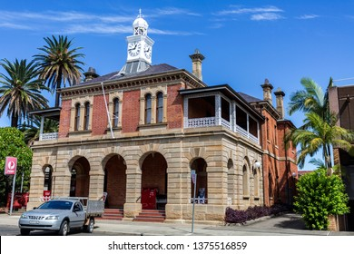 GRAFTON, AUSTRALIA – April 9, 2019: Facade of the heritage building of the Post Office, built in 1874 with sombre sandstone colonnades and local bricks, in central Grafton, NSW, Australia