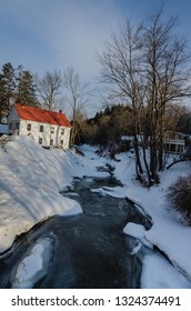 Grafton, NY / USA - 03-06-2015: Frozen winter landscape in Grafton, Vermont includes Saxton River creek and the Old Fire Station.