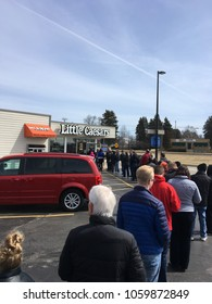"Grafton Wisconsin, USA, April 2 2018: little Caesars pizza was giving out free lunch. NCAA payoff when a 16 seed beat a #1. ""CRAZY HAPPENED"" Free lunch combo."
