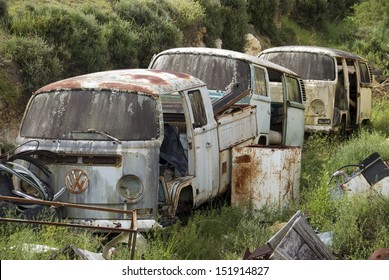 GRAHAMSTOWN, SOUTH AFRICA - February 21: Several old Volkswagen Camper vans lie rusting away in a ditch on a dairy farm on February 21, 2011 in Grahamstown, South Africa.