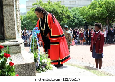 GRAHAMSTOWN, SOUTH AFRICA - NOVEMBER 11, 2018: Mayor Nomhle Gaga lays a wreath at a monument to fallen soldiers during a ceremony to mark the centenary of the Armistice that ended World War One.