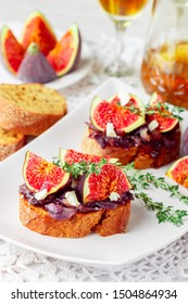 Grain baguette sandwiches with figs, feta cheese, red onion marmalade and thyme . Delicious snack for gourmands. Selective focus