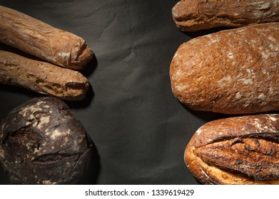 grain bread and fig bread with prunes on dark background