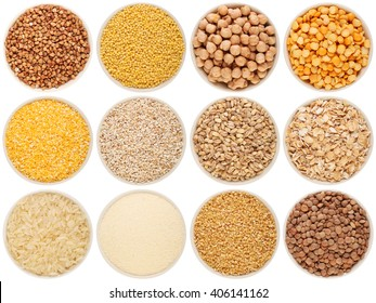 Grain and cereal food selection in porcelain bowls: buckwheat, millet, chick-pea, peas, crushed corn, crushed barley; barley, oat flakes, rice, semolina, crushed wheat; lentil. Isolated on white.