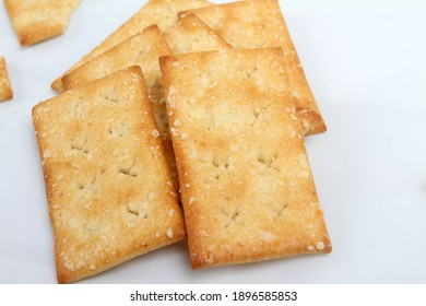Grain of cheese crackers biscuits isolated on white background