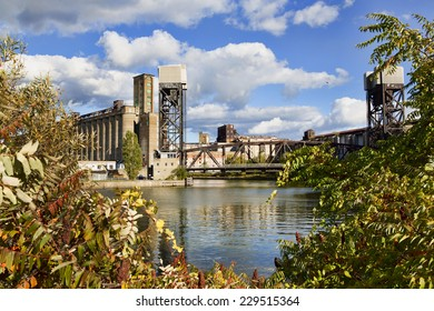 Grain elevator along the Buffalo, New York waterfront. The building, which was at one time the largest grain elevator in the world, is shot so it is framed by autumn-leaved trees.