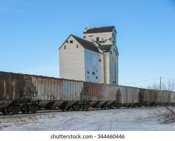 Grain Elevator and Annex with Train in Winter