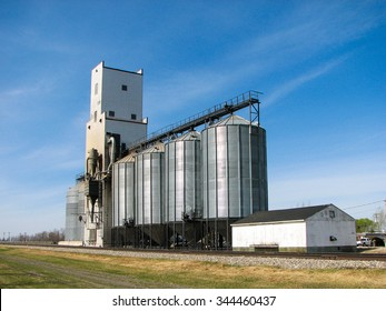 Grain Elevator and Bins with Blue Sky