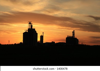 grain elevators against fiery sunset