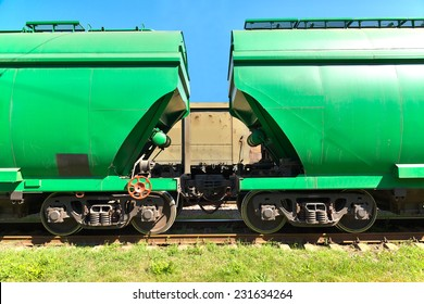 Grain hoppers on the railway track - cars coupling