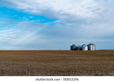 Grain silos sit isolated in the middle of agricultural farm land on an early December day in northeast Montana, USA.