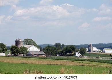grain wheat metallic silo on cloudy sky background with farm