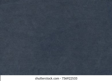 grained textile texture and background of cotton fabric or jeans material of dark blue color