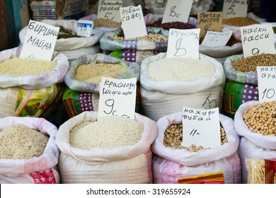 Grains and beans groceries in bulk bags at market, Khojant, Tajikistan, Central Asia