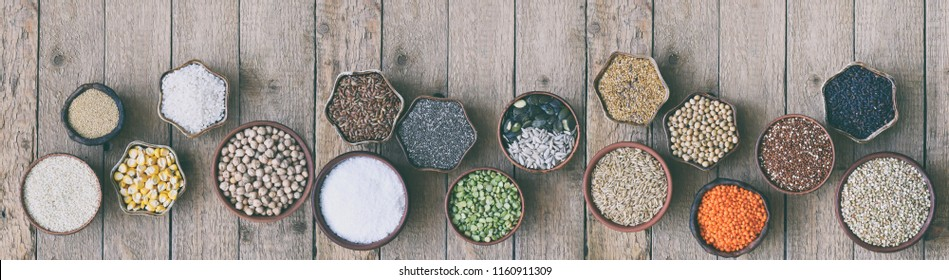 Сereals, grains, beans and seeds. Millet, quinoa, corn, buckwheat, rice, amaranth, chickpea, coconut, chia, soy, oats, lentils.  Gluten-free concept. Healthy food. Top view. Copy space.