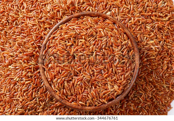 Grains of Camargue red rice in a glass bowl