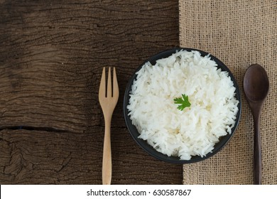 grains cooking of Thai jasmine or white rice in bowl on wooden Background